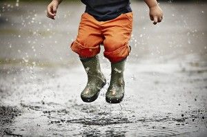 puddle jumping is a favorite child's past time