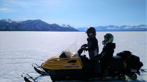 riding snowmachines for fun in Alaska