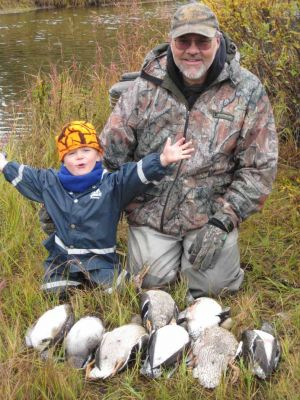 Duck hunting with papa makes for a happy child